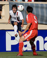 Sacha Kljestan kicks as China's Sun Xiang eyes the ball. The USA defeated China, 4-1, in an international friendly at Spartan Stadium, San Jose, CA on June 2, 2007.