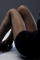 Woman's legs in fish net stockings<br />