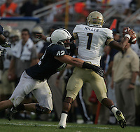 State College, PA - 09/15/2012:  Penn State LB Michael Mauti pursues Navy QB Trey Miller.  Mauti led all defenders with 12 tackles.  Penn State defeated Navy by a score of 34-7 on Saturday, September 15, 2012, at Beaver Stadium.  The win was the first for new Penn State head coach Bill O'Brien...Photo:  Joe Rokita / JoeRokita.com..Photo ©2012 Joe Rokita Photography