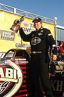 Mar. 13, 2011; Gainesville, FL, USA; NHRA top fuel dragster driver Del Worsham celebrates after winning the Gatornationals at Gainesville Raceway. Mandatory Credit: Mark J. Rebilas-