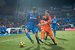 Jorge Molina Vidal (L) of Getafe CF fights for the ball with Federico Ricca Rostagnol of Malaga CF  during the La Liga 2017-18 match between Getafe CF and Malaga CF at Coliseum Alfonso Perez on 12 January 2018 in Getafe, Spain. Photo by Diego Gonzalez / Power Sport Images