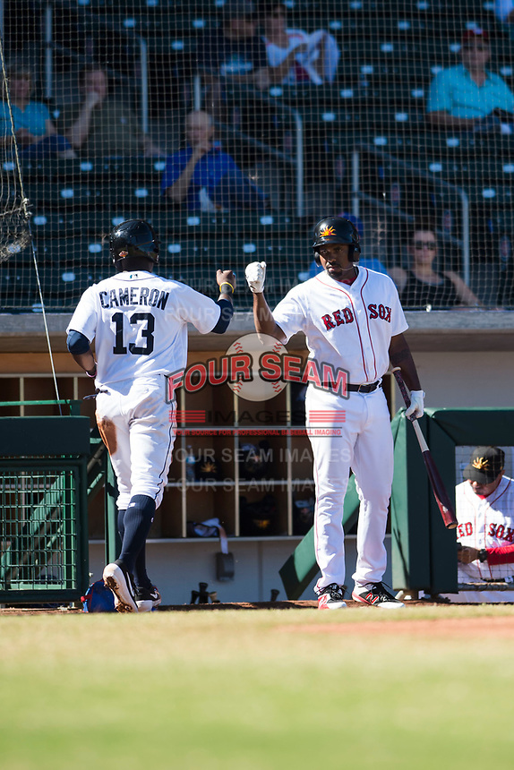 Mesa Solar Sox first baseman Josh Ockimey (28), of the Boston Red Sox organization, congratulates Daz Cameron (13) after scoring a run during an Arizona Fall League game against the Glendale Desert Dogs at Sloan Park on October 27, 2018 in Mesa, Arizona. Glendale defeated Mesa 7-6. (Zachary Lucy/Four Seam Images)