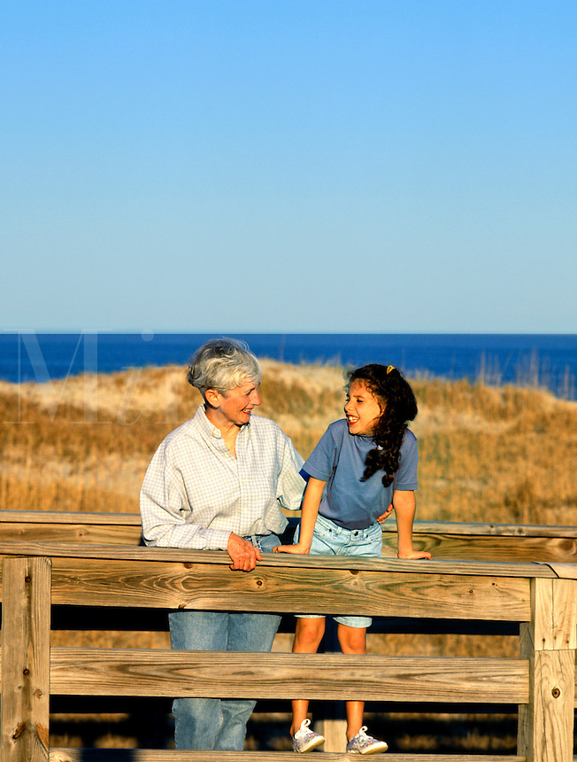 Grandmother and granddaughter share a a playful vacation moment