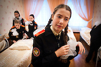 RUSSIA, Moscow, 11.2010. ©  Sergey Kozmin/EST&OST.The Moscow Girls Cadet Boarding School..The school day usually begins at 7am. The girls make their beds and prepare for classes.