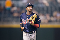 Gwinnett Braves left fielder Ronald Acuna (24) blows a bubble with his gum as he jogs off the field between innings of the game against the Charlotte Pitmasters at BB&T BallPark on July 15, 2017 in Charlotte, North Carolina.  The Braves defeated the Pitmasters 9-4.  (Brian Westerholt/Four Seam Images)
