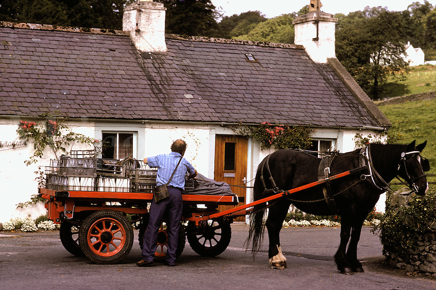 Scotland, Galloway.  Moniaive.  Milkman delivering milk with horse and cart.