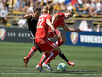 Christine Sinclair (left), Becky Sauerbrunn (22) and Cat Whitehill (right) battle for the ball. FC Gold Pride defeated Washington Freedom 3-2 at Buck Shaw Stadium in Santa Clara, California on August 1, 2009.