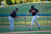 AZL Indians Blue Cristopher Cespedes (17) is congratulated by manager Larry Day (27) after hitting a home run during an Arizona League game against the AZL White Sox on July 2, 2019 at Camelback Ranch in Glendale, Arizona. The AZL Indians Blue defeated the AZL White Sox 10-8. (Zachary Lucy/Four Seam Images)