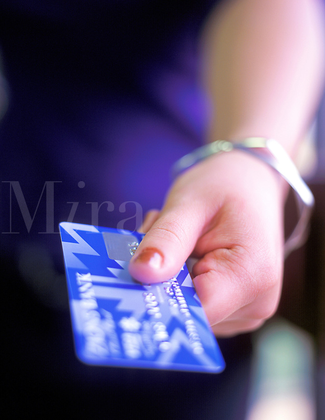 Close up of female's hand holding a credit card