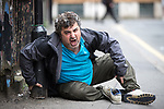 © Joel Goodman - 07973 332324 . 06/04/2017 . Manchester , UK . A man appears disorientated and screams out incoherently as he sits forward on the pavement on Newton Street . An epidemic of abuse of the drug spice by some of Manchester's homeless population , in plain sight , is causing users to experience psychosis and a zombie-like state and is daily being witnessed in the Piccadilly Gardens area of Manchester , drawing large resource from paramedic services in the city centre . Photo credit : Joel Goodman