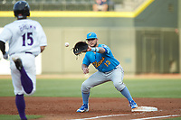 Myrtle Beach Pelicans first baseman Tyler Alamo (13) waits for a throw as Nolan Brown (15) of the Winston-Salem Dash hustles down the line at BB&T Ballpark on August 6, 2018 in Winston-Salem, North Carolina. The Dash defeated the Pelicans 6-3. (Brian Westerholt/Four Seam Images)