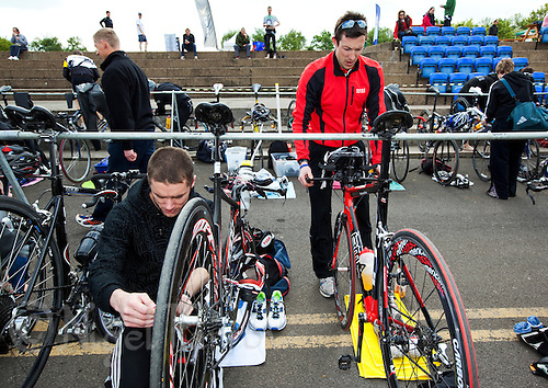 14 MAY 2010 - HOLME PIERREPONT, GBR - Competitors prepare in transition before the start of the VUE National Emergency Services Triathlon Championships (PHOTO (C) NIGEL FARROW)