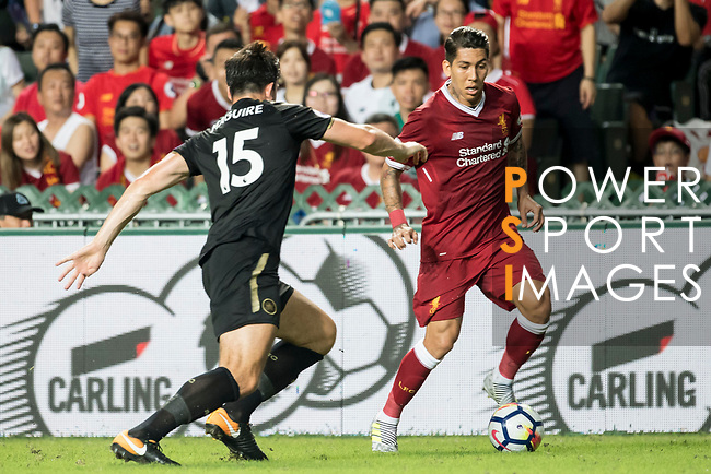 Liverpool FC forward Roberto Firmino (R) competes for the ball with Leicester City FC defender Harry Maguire during the Premier League Asia Trophy match between Liverpool FC and Leicester City FC at Hong Kong Stadium on 22 July 2017, in Hong Kong, China. Photo by Weixiang Lim / Power Sport Images