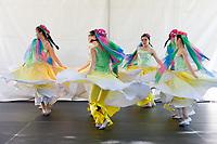 Girls dancing Chinese Hats and Scarfs Dance, Northwest Folklife Festival 2016, Seattle Center, Washington, USA.