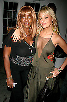 JANICE COMBS AND NICOLE RICHIE<br /> OLYMPUS FASHION WEEK: <br /> ZAC POSEN SPRING 2005-CELEBS.<br /> BRYANT PARK,NEW YORK CITY 9/10/2004<br /> Photo By John Barrett/PHOTOlink /MediaPunch