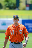 Matt Duffy (17)  of the Fresno Grizzlies warms up in the outfield before the game against the Salt Lake Bees in Pacific Coast League action at Smith's Ballpark on June 14, 2015 in Salt Lake City, Utah.  (Stephen Smith/Four Seam Images)