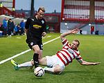 Craig Reid tackled by Ziggy Gordon