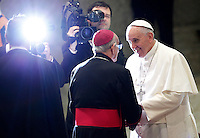 Papa Francesco saluta i vescovi al termine dell'udienza generale del mercoledi' in aula Paolo VI, Citta' del Vaticano, 21 gennaio 2015.<br /> Pope Francis greets bishops at the end of his weekly general audience in the Paul VI hall at the Vatican, 21 January 2015.<br /> UPDATE IMAGES PRESS/Isabella Bonotto<br /> <br /> STRICTLY ONLY FOR EDITORIAL USE