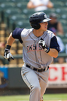 Colorado Springs Sky Sox outfielder Corey Dickerson (23) runs to first base against the Round Rock Express in the Pacific Coast League baseball game on May 19, 2013 at the Dell Diamond in Round Rock, Texas. Colorado Springs defeated Round Rock 3-1 in 10 innings. (Andrew Woolley/Four Seam Images).