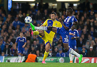 Ramires of Chelsea beats Nikola Mitrovic of Maccabi Tel Aviv to the ball during the UEFA Champions League match between Chelsea and Maccabi Tel Aviv at Stamford Bridge, London, England on 16 September 2015. Photo by Andy Rowland.