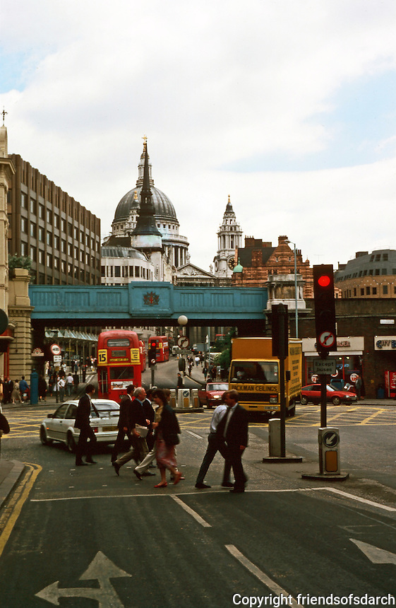London:   Ludgate Circus--After Rude. Looking up Ludgate Hill to St. Paul's from the Fleet.  The Spire of St. Martin's Ludgate Hill (also Wren) bisects St. Paul's Dome.  Photo '90.