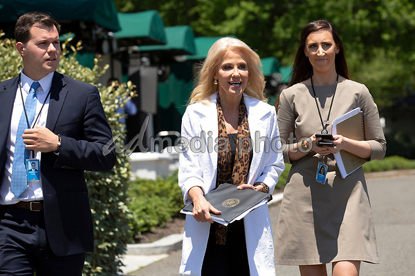 Senior Counselor Kellyanne Conway, center, departs a television interview outside the White House in Washington, D.C., U.S., on Monday, June 15, 2020.  Credit: Stefani Reynolds / CNP/AdMedia