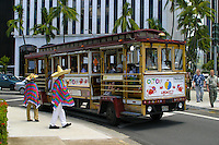 Tourist enjoy taking in the sights of Oahu on the Waikiki Trolley. Here shoppers are dropped off near the Aloha Tower Marketplace in downtown Honolulu,Oahu.