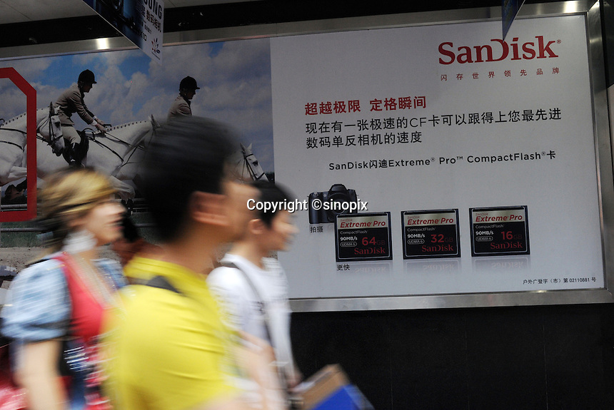 An advertisement for SanDisk in Guangzhou, China. China's retail sales, the main gauge of consumer spending in the world's fastest-growing economy, rose 18.5 percent year on year to 1.15 trillion yuan (168.52 billion U.S. dollars) in April..