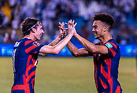 SAN PEDRO SULA, HONDURAS - SEPTEMBER 8: Brenden Aaronson #11 and Antonee Robinson #5 of the United States high five after a game between Honduras and USMNT at Estadio Olímpico Metropolitano on September 8, 2021 in San Pedro Sula, Honduras.