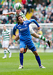 Celtic v St Johnstone....01.04.12   SPL.Scott Brown gets above Fran Sandaza.Picture by Graeme Hart..Copyright Perthshire Picture Agency.Tel: 01738 623350  Mobile: 07990 594431