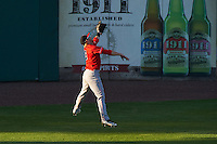 Louisville Bats center fielder Bryson Smith (3) makes a leaping catch on a fly ball during a game against the Syracuse Chiefs on June 6, 2016 at NBT Bank Stadium in Syracuse, New York.  Syracuse defeated Louisville 3-1.  (Mike Janes/Four Seam Images)