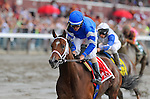 Alpha, with jockey Ramon Dominguez in the irons, wins the Jim Dandy on Jim Dandy Day at Saratoga Race Course in Saratoga Springs, New York on July 28, 2012