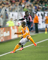 New England Revolution midfielder Saer Sene (39) and Houston Dynamo defender Corey Ashe (26) attempt to control the ball at the sideline.  The New England Revolution played to a 1-1 draw against the Houston Dynamo during a Major League Soccer (MLS) match at Gillette Stadium in Foxborough, MA on September 28, 2013.