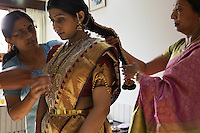 This is an arranged marriage between two coffee plantation owner families 5 hours from Bangalore in Chikmagalur, India.  The girls family approached the wealthier coffee plantation family and was accepted.  She is wearing the wedding jewelry of her extended family.  The piece in her hair is 2KG and over 100 years old.  The workmanship places its value at around $500,000 USD.  Total wealth hanging off this bride is about $700,000.  There were times when it was painful for her to keep her head straight...We drove to Chikmagalur and first met up with the bride Nagavika C.R. (+91 97405 33535, nagavi.r@gmail.com) at her house. On that day, we also met her father Mr. Ravi Shankar, sisters Kavya and Supreetha. Her cousin Shilpa Kiran was the one who was explaining about the jewellery to us...We also drove up to meet the groom Vignesh Gowda (+91 99720 61576, vigneshgowda@gmail.com) at his plantation, Bynacool Estate...Main contact is fixer Vinay Diddee his wife Neha made many of the arrangements..vinaydiddee@latitude.co.in.house number is +91 80 4132 0578. Vinay cell +91 98450 91377 and Neha's +91 98450 53695