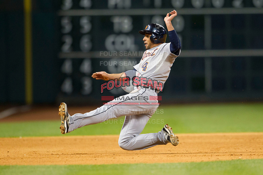 Detroit Tigers second baseman Omar Infante (4) slides into third base during the fifth inning of the MLB baseball game against the Houston Astros on May 3, 2013 at Minute Maid Park in Houston, Texas. Detroit defeated Houston 4-3. (Andrew Woolley/Four Seam Images).