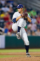 Blaine Hardy (36) of the Northwest Arkansas Naturals winds up during a game against the Springfield Cardinals and the Springfield Cardinals at Hammons Field on July 30, 2011 in Springfield, Missouri. Springfield defeated Northwest Arkansas 11-5. (David Welker / Four Seam Images)