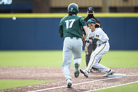 Michigan Wolverines first baseman Jake Marti (7) waits for a throw against the Michigan State Spartans on March 22, 2021 in NCAA baseball action at Ray Fisher Stadium in Ann Arbor, Michigan. Michigan State beat the Wolverines 3-0. (Andrew Woolley/Four Seam Images)
