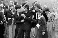 Pix: Copyright Anglia Press Agency/Archived via SWpix.com. The Bamber Killings. August 1985. Murders of Neville and June Bamber, daughter Sheila Caffell and her twin boys. Jeremy Bamber convicted of killings serving life...copyright photograph>>Anglia Press Agency>>07811 267 706>>..A weeping Jeremy Bamber is comforted by his girlfriend Julie Mugford at the funeral of his family, alongside Colin Caffell, father and husband of victims. no date..ref 0006 neg 19.