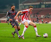 29th December 2020; Bet365 Stadium, Stoke, Staffordshire, England; English Football League Championship Football, Stoke City versus Nottingham Forest; Harry Souttar of Stoke City defends from Lewis Grabban of Nottingham Forest