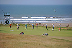 Players practising on the first green ahead of The Senior Open Golf Tournament at The Royal Porthcawl Golf Club in South Wales, which begins tomorrow.
