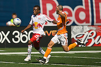 New York Red Bulls midfielder Dane Richards (19) is chased by Houston Dynamo defender Wade Barrett (24). The New York Red Bulls defeated the Houston Dynamo 3-0 during a Major League Soccer match at Giants Stadium in East Rutherford, NJ, on August 24, 2008.