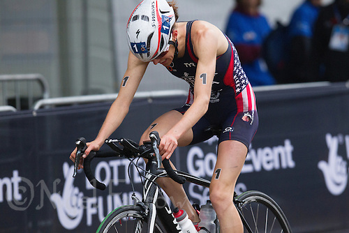 14 SEP 2013 - LONDON, GBR - Gwen Jorgensen (USA) of the USA cycles slowly round the course after her accident during the elite women's ITU 2013 World Triathlon Series Grand Final in Hyde Park, London, Great Britain (PHOTO COPYRIGHT © 2013 NIGEL FARROW, ALL RIGHTS RESERVED)