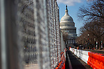 Fences and barricades stand in front of the U.S. Capitol ahead of President-Elect Joe Biden's Inauguration on January 19, 2021 in Washington, D.C..  Photograph by Michael Nagle