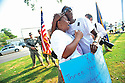Patrina Peters hugs a Geneva Seals during a memorial ceremony on the third anniversary of Hurricane Katrina in the Lower Ninth Ward of New Orleans, 2008.