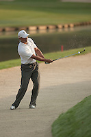 PONTE VEDRA BEACH, FL - MAY 6: Tiger Woods hits onto the 11th green from a green-side bunker during his practice round on Wednesday, May 6, 2009 for the Players Championship, beginning on Thursday, at TPC Sawgrass in Ponte Vedra Beach, Florida.