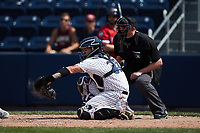 Scranton/Wilkes-Barre RailRiders catcher Donny Sands (33) receives a pitch as home plate umpire Jacob Metz looks on during the game against the Rochester Red Wings at PNC Field on July 25, 2021 in Moosic, Pennsylvania. (Brian Westerholt/Four Seam Images)