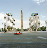 A taxi crosses Brezhnevs Square, a monument to independance, in Almaty, Kazakhstan