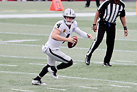 27th September 2020, Foxborough, New England, USA;  Las Vegas Raiders quarterback Derek Carr (4) scrambles from the pocket during the game between the New England Patriots and the Las Vegas Raiders