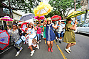 Members of the Baby Doll Sisterhood second line in memory of Baby Doll Tee Eva Perry, who died at 83 on June 7, in New Orleans, La. Monday, June 11, 2018.
