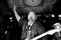 "Charles ""Skip"" Pitts of the Bo-Keys plays his guitar at the 8th annual Ponderosa Stomp, held at the House of Blues in New Orleans on April 28, 2009. <br /> <br /> The Bo-Keys are a new old band, formed in 1998 by Memphis musician Scott Bomar who was asked to assemble a backup band for former Stax Records artist Sir Mack Rice.  Bomar then went to the source and enlisted former Stax session musicians Skip Pitts, Howard Grimes, and Ben Cauley.  Skip Pitts is perhaps best known for creating the distinctive ""wah wah"" guitar sound for the title track of Isaac Hayes' record ""Shaft"".       <br /> <br /> The Ponderosa Stomp is an annual music festival held in New Orleans since 2002 that celebrates the uncelebrated names in American musical history.  The festival spotlights musicians who have contributed to the American roots musical canon in various genres, from rockabilly to soul to rock and roll to jazz to experimental.  For two nights of the year these mostly forgotten names perform to an audience of aficionados whose memory has not faded and turn back the clock with blistering performances of the hits that did or (in the case of the regional musicians that plugged away unknown to the world at large, as well as those whose songs were recorded to acclaim by other musicians) did not make them famous.  <br /> <br /> In addition to the two nights of performances the Ponderosa Stomp Foundation (the non-profit founded by the eccentric Dr. Ira Padnos and his coterie of like minded music fanatics the Mystic Knights of the Mau Mau) also produces two days of the Music History Conference, where many of the performers, as well as other music industry names, share stories of their lives in the business.  The Conferences take place in the Louisiana State Museum at the Cabildo in Jackson Square."